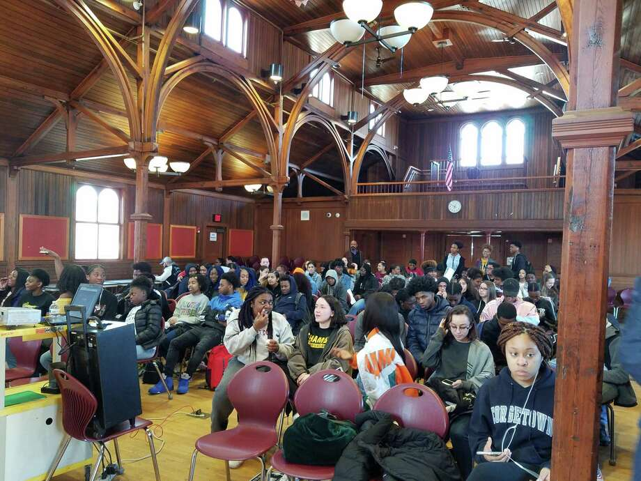 """New Haven and Yale police officers, New Haven school administrators, and over 80 high school students from Career, Cooperative Arts, Hillhouse and Wilbur Cross recently assembled at the Betsy Ross Arts and Magnet Parish Hall to view the documentary video """"Walking While Black."""" Photo: Contributed /"""