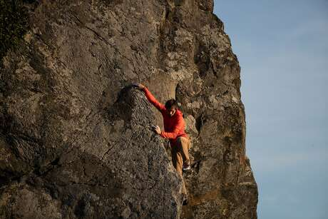 Big-wall climber and Santa Rosa-native Kevin Jorgeson scales up one of the Sunset Boulders near Goat Rock Beach. Photo: Paul Kuroda / Special To The Chronicle