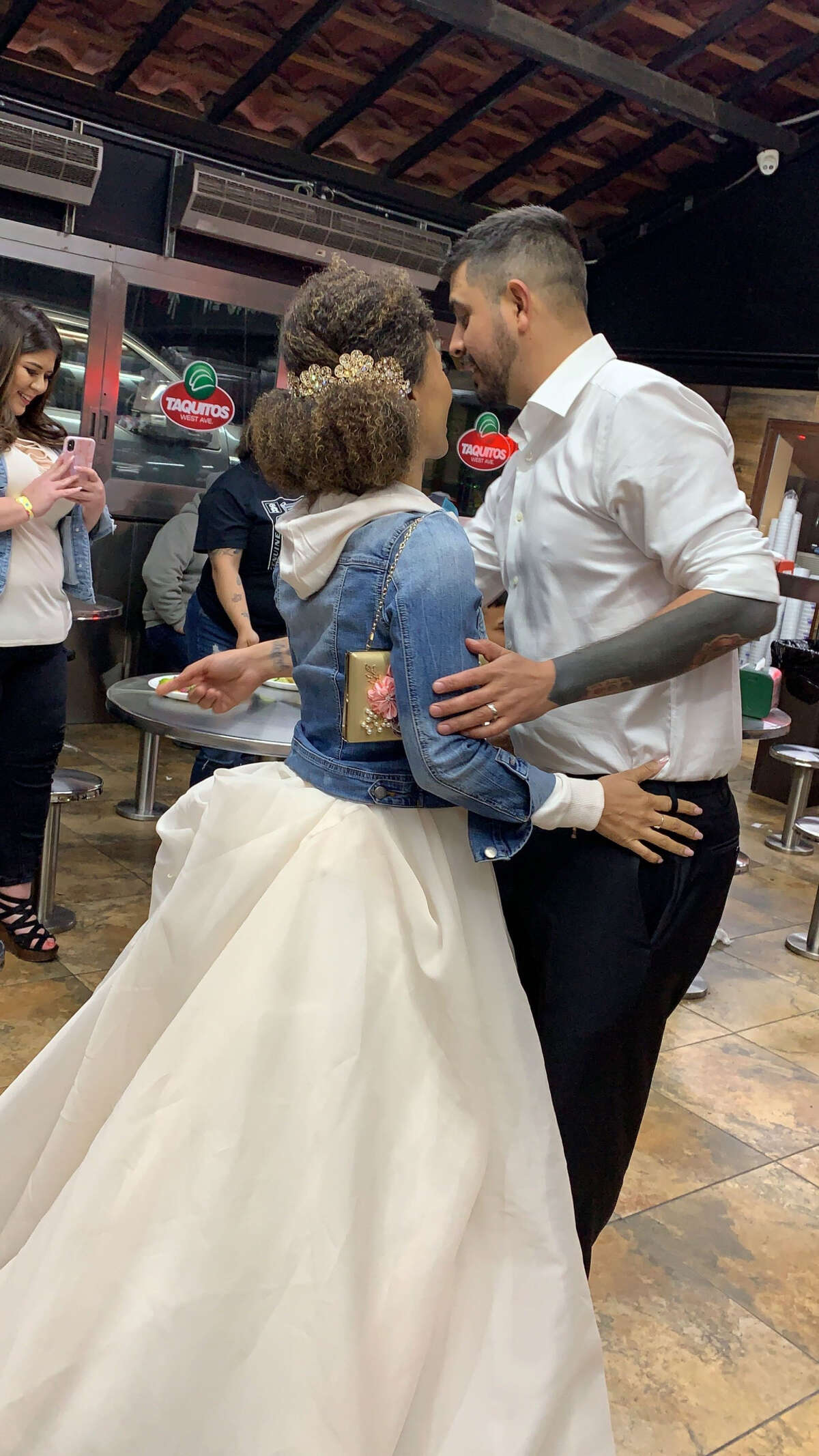 Twitter user Samantha Figueroa caught the unnamed love birds at the popular taquitos spot located at 2818 West Avenue Saturday night.