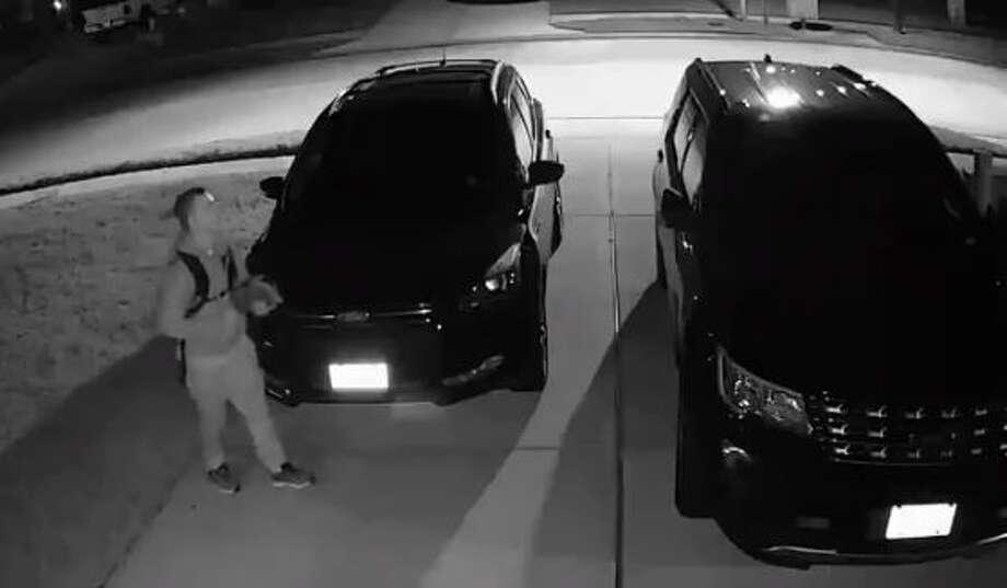 A man is seen in this image from surveillance video prior to allegedly stealing a loaded pistol and several other items from vehicles on a Conroe driveway. Photo: Courtesy Of The Montgomery County Sheriff's Office