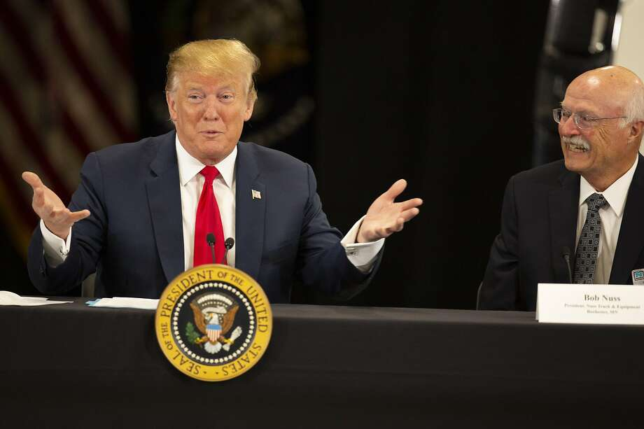 President Trump talks with Bob Nuss of Nuss Truck and Equipment in Burnsville, Minn., during a roundtable discussion on tax cuts and the economy. Photo: Andy Clayton-King / Associated Press