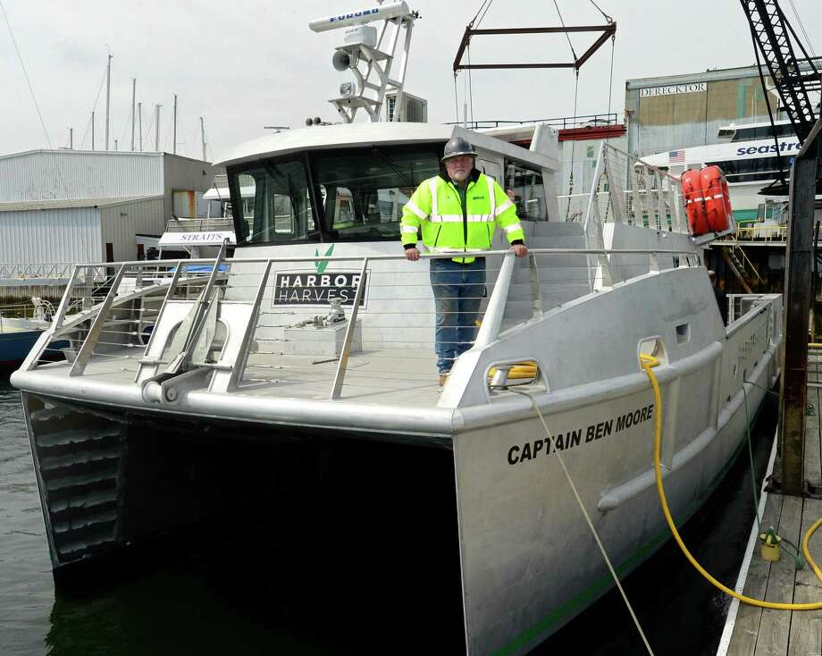 Norwalk native, boat builder and owner of Harbor Harvest market, Robert Kunkel, his friends, family and associates, help launch the northeast's first hybrid electric catamaran with refrigeration, The Captain Ben Moore, on Friday April 12, 2019, at Derecktor Shipyards in Mamoroneck, NY. The launch of the vessel is the first step toward Kunkel's goal of creating an emissions-free eco-delivery marine coastal farm-to-table distribution network and taking the stress off I-95. Photo: Erik Trautmann / Hearst Connecticut Media / Norwalk Hour