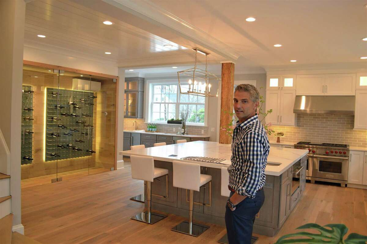 Real estate developer John Paul shows off the new interior of the Sherman Parsonage at 480 Old Post Road at an open house on Thursday, April 11, 2019, in Fairfield, Conn.