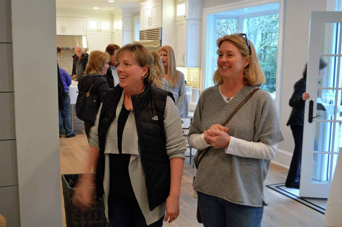 Lakin Hughes Schostak of Fairfield, left, who grew up in the 200-year-old house, and her friend Sara McEldowney Jannott of Fairfield, relive history at the Sherman Parsonage at 480 Old Post Road at an open house on Thursday, April 11, 2019, in Fairfield, Conn.