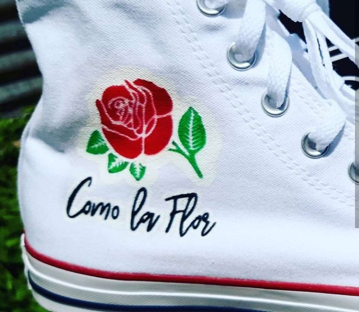 Juan Garcia III, owner of J3 Customs, created art fit for the Tejano Queen on a pair of Converse for a fan named Jorge Bernal. Garcia said Bernal contacted him with the idea to create a Selena-themed pair to wear to Fiesta de la Flor, the annual festival celebrating Selena's life and legacy, and Garcia was happy to get the job done.