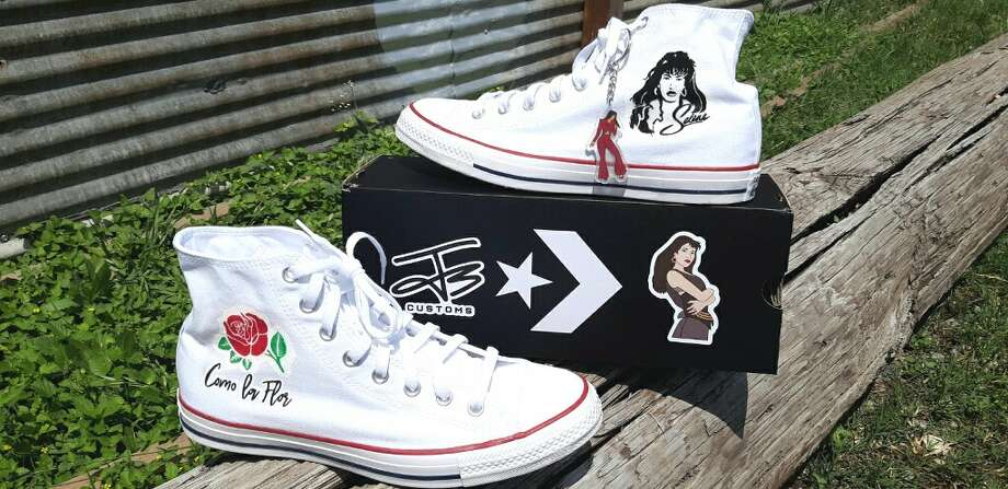 Juan Garcia III, owner of J3 Customs, created art fit for the Tejano Queen on a pair of Converse Chuck Taylor All Stars for a fan named Jorge Bernal. Garcia said Bernal contacted him with the idea to create a Selena-themed pair to wear to Fiesta de la Flor, the annual festival celebrating Selena's life and legacy, and Garcia was happy to get the job done. Photo: Courtesy, Juan Garcia