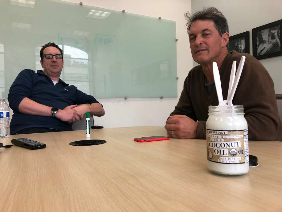 SFGATE's Chris Preovolos and David Curran anxiously eye solid jar of coconut oil used in our oil pulling experiment. Photo: Filipa Ioannou