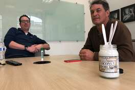 SF Gate's Chris Preovolos, David Curran and Bill Disbrow enjoy heaping spoonfuls of Trader Joe's organic virgin coconut oil.