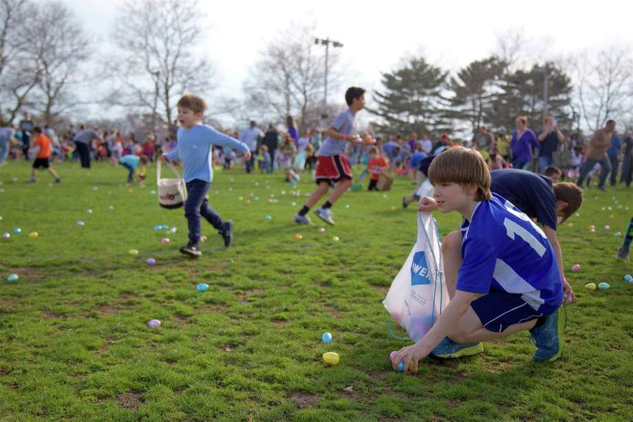 Egg collecting was at a fast pace at the Easter Eggstravaganza 2019 at the South Pine Creek Complex, Saturday, April 13, 2019, in Fairfield, Conn. Photo: Jarret Liotta / For Hearst Connecticut Media / Fairfield Citizen News Freelance