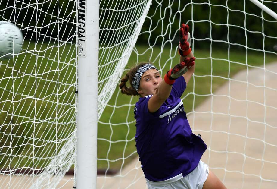 Atascocita senior goalkeeper Ainsley Cunningham works in vain to block a Tompkins shot on goal during a shootout in their Region III-6A Girls Soccer semifinal matchup at Abshier Stadium in Deer Park on April 12, 2019. Photo: Jerry Baker, Houston Chronicle / Contributor / Houston Chronicle
