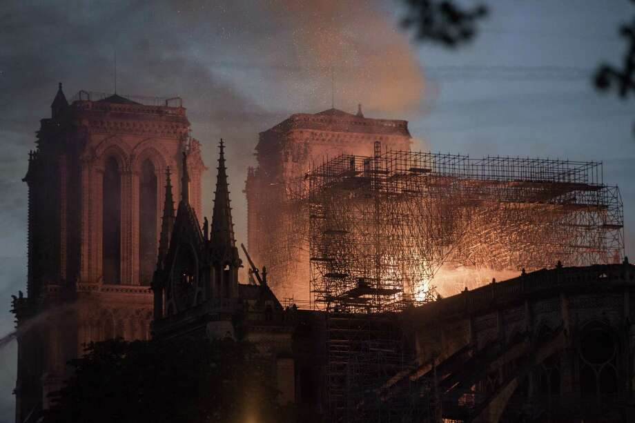 Flames and smoke rise from a fire at Notre Dame Cathedral in Paris on Monday. The cathedral is 850 years old. Photo: Bloomberg Photo By Martin Barzilai / Bloomberg