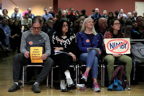 Matthew Frinzi, Juanita Luna, Jan Duffy, and April Long, locals with differing opinions of the proposed center, listen to speakers at the Delancey Street Foundation auditorium where city officials and neighborhood residents discussed a proposed navigation center for the homeless in San Francisco, Calif., on Wednesday, April 3, 2019.