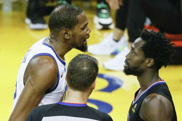 1fb856605014 1of5Golden State Warriors Kevin Durant and Los Angeles Clippers Patrick  Beverley share words in the fourth quarter during game 1 of the Western  Conference ...