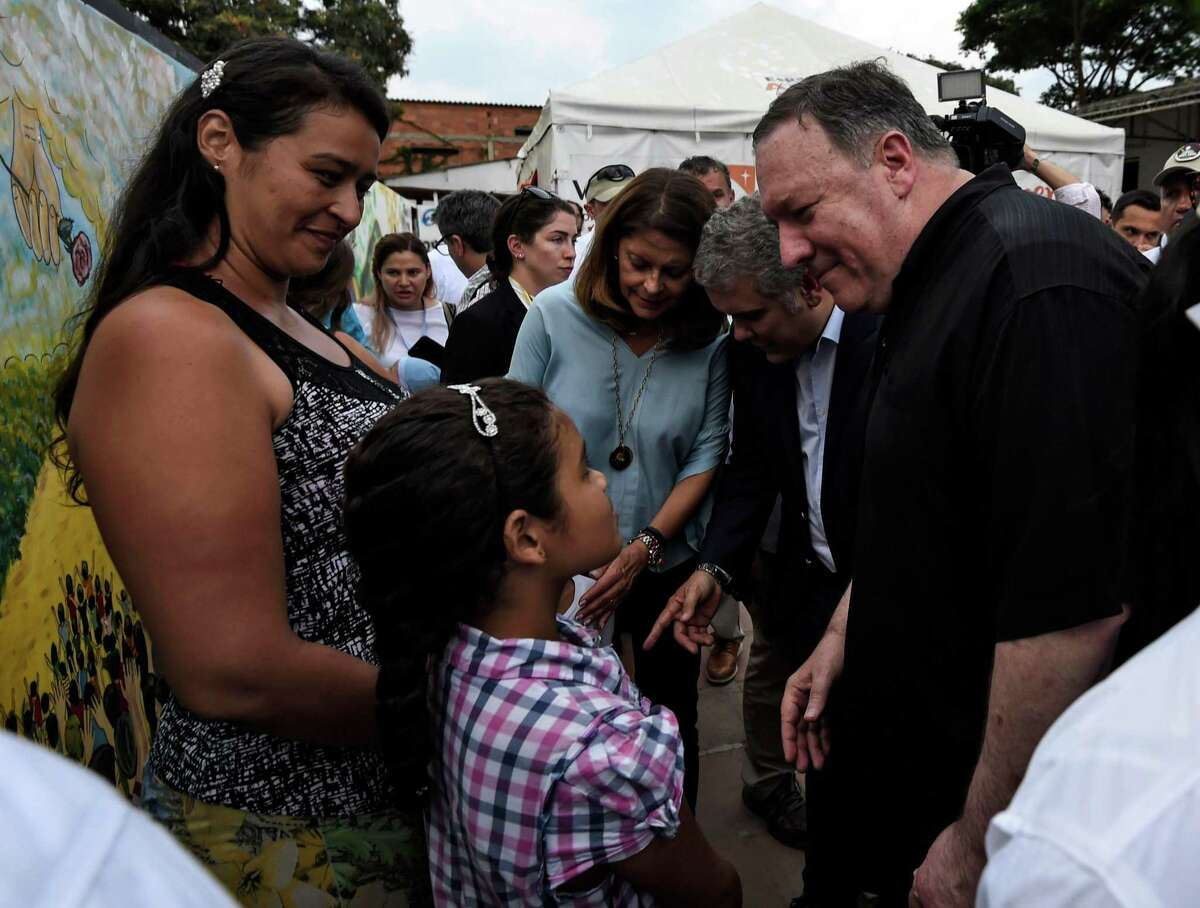 Secretary of State Mike Pompeo with Colombian President Ivan Duque talks with Venezuelan refugees during a visit to the Transitional Attention for the Migrant Office in Cucuta, Norte del Santander Department, Colombia, on April 14, 2019.
