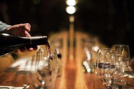 Pouring wine at a Sonoma vineyard in 2015. MUST CREDIT: Washington Post photo by Melina Mara