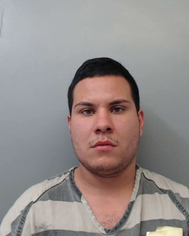 Alfredo Menchaca, 24, was charged with theft and evading arrest. Photo: Webb County Sheriff's Office