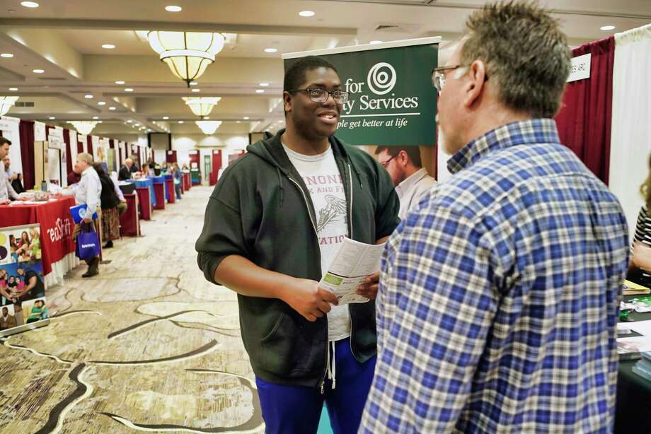 Michael Bell, left, of Watervliet, talks with Ron Zinoman, a recruiter for the Center for disability Services, at the Times Union Job Fair at the Albany Marriott hotel on Monday, April 15, 2019, in Albany, N.Y.   (Paul Buckowski/Times Union) Photo: Paul Buckowski / (Paul Buckowski/Times Union)