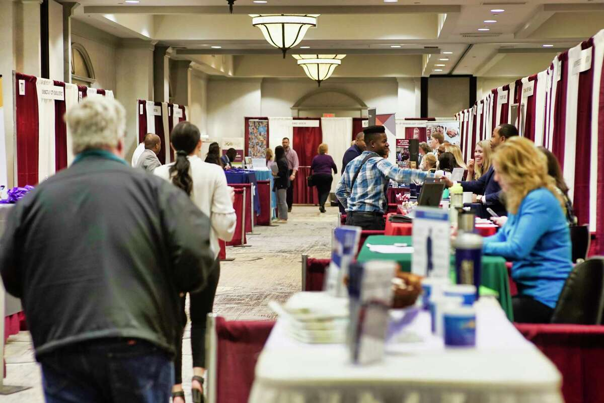 People make their way around to talk to the various employers at the Times Union Job Fair at the Albany Marriott hotel on Monday, April 15, 2019, in Albany, N.Y. (Paul Buckowski/Times Union)