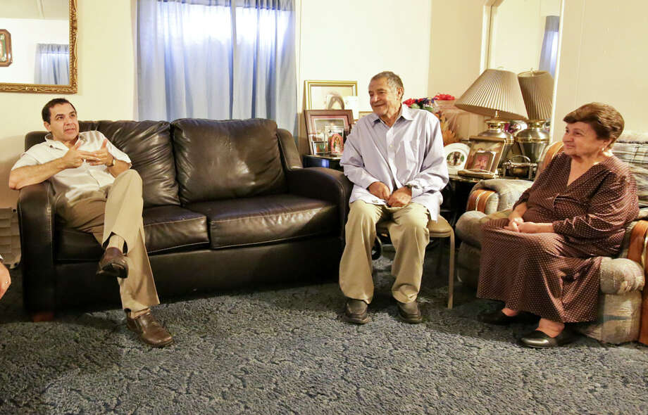 Congressman Henry Cuellar, left, is joined by his parents Mr. Martin S. Cuellar and Mrs. Odilia Cuellar during an interview at Cuellar's parents home in Laredo, TX on Sunday, Sept. 14, 2014. Photo: Victor Strife/Laredo Morning Times