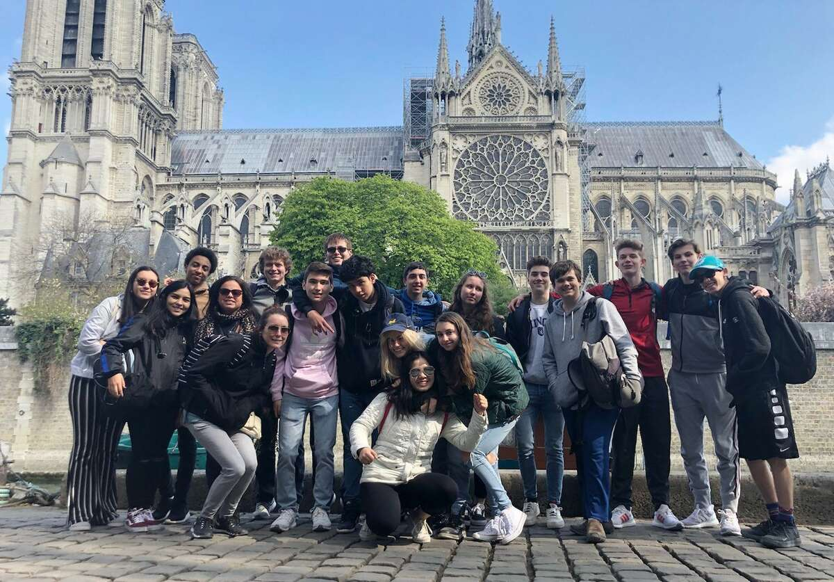 Stanwich School teacher Anais Latimore's class poses at Notre Dame during their visit to France.