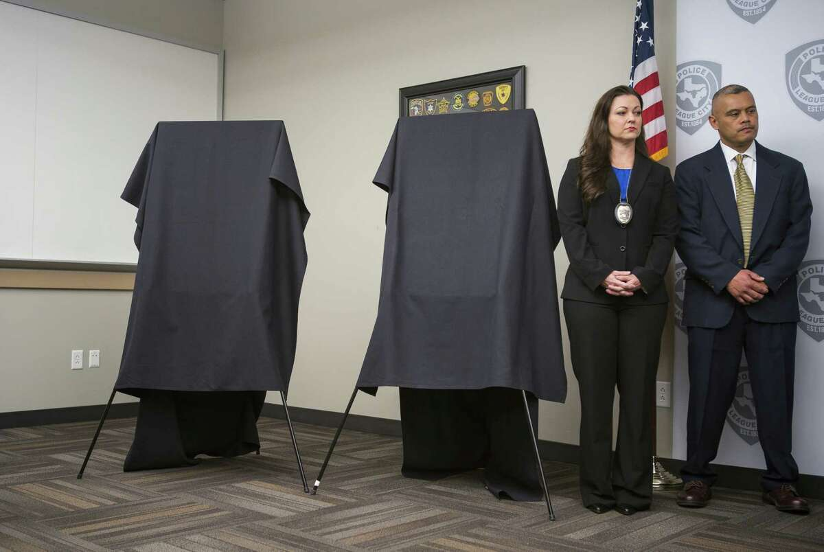 """Law enforcement officials wait to announce the identities of two previously unidentified women who were found dead along with two other women between 1985 and 1991 in an area off of Calder Road in League City during a press conference at the League City Police Department, Monday, April 15, 2019. The victim known as """"Jane Doe"""" was identified as Audrey Lee Cook, who police estimated was about 30 at the time her body was found in 1986. The other woman, known until now as """"Janet Doe,"""" was Donna Prudhomme, about 34 when her body was found in 1991."""