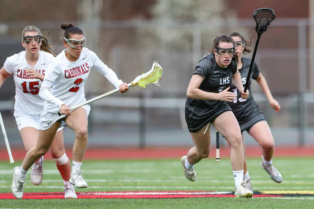 Kay Conway (3) of Longmeadow and Paige Finneran (2) of Greenwich race for a loose ball during a game between Greenwich Girls Varsity Lacrosse and Longmeadow Girls Varsity Lacrosse on April 15, 2019 at Greenwich High School in Greenwich, CT.