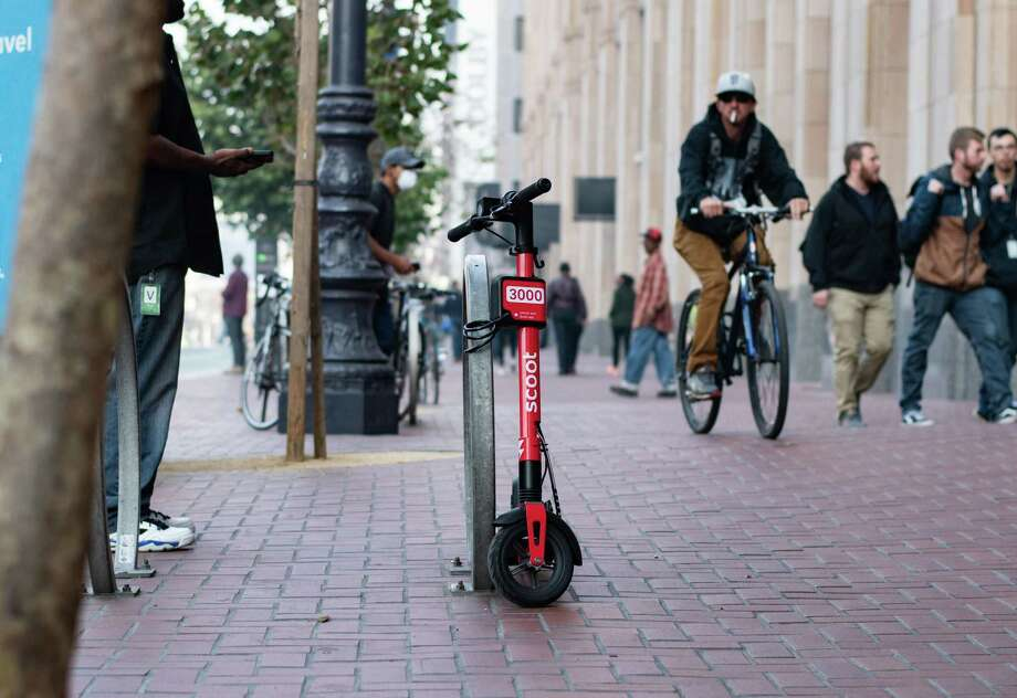 Scoot is one of four e-scooter companies that received permits to operate in San Francisco, beginning Oct. 15, 2019. The permits will allow each company to operate an initial 1,000 scooters in the city, with the possibility of ramping that figure to 2,500 e-scooters per company. The initial rollout of e-scooters led to several problems and complaints from residents and workers in San Francisco. Scroll through the slideshow to see how e-scooters were welcomed to the city back in March 2018. Photo: Scoot
