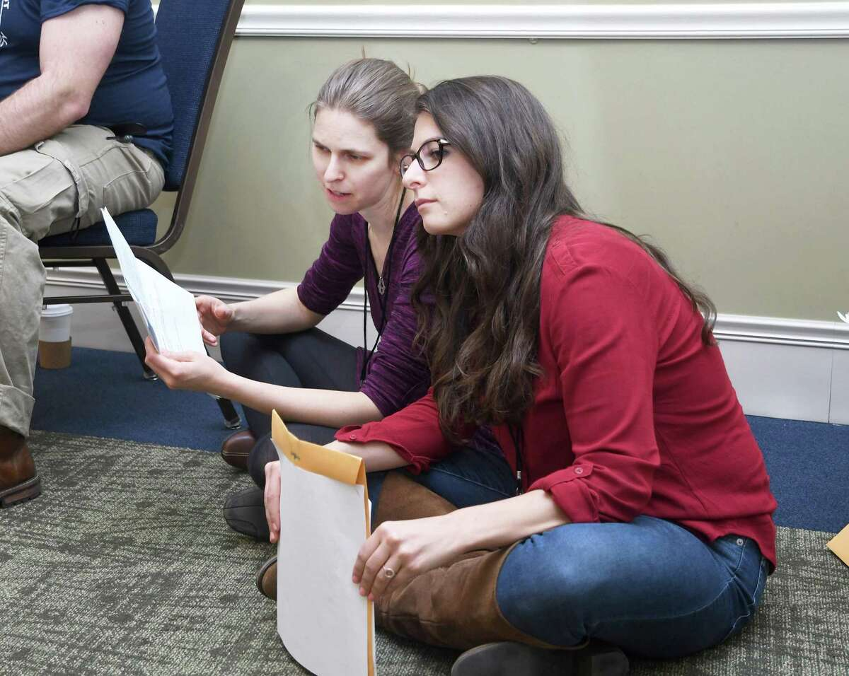 Western Connecticut State University students Tal Hadani-Pease, left, of Sherman, and Chelsea Honeyman, of Bethel, watch a simulation during a training session for counseling and nursing graduate students at the university, April 15, 2019.