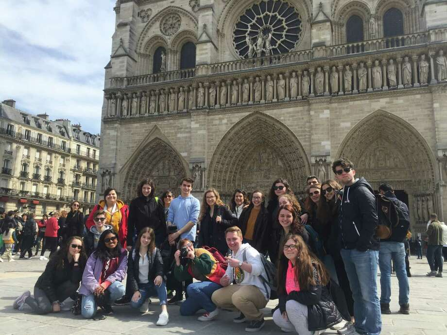 Shenendehowa students pose for a picture in front of Notre Dame Monday afternoon, April 15, just hours before a fire tore through the cathedral leaving extensive damage.  Photo: Provided By Karen Bonventre