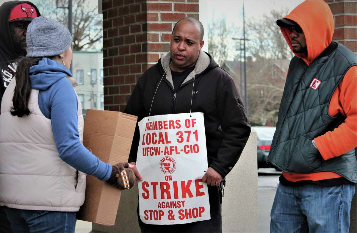 Kevin Hall, center, of New Haven, picketed at the Stop & Shop store where he's worked for five years just a few blocks from where he lives, Monday, April 15, 2019.