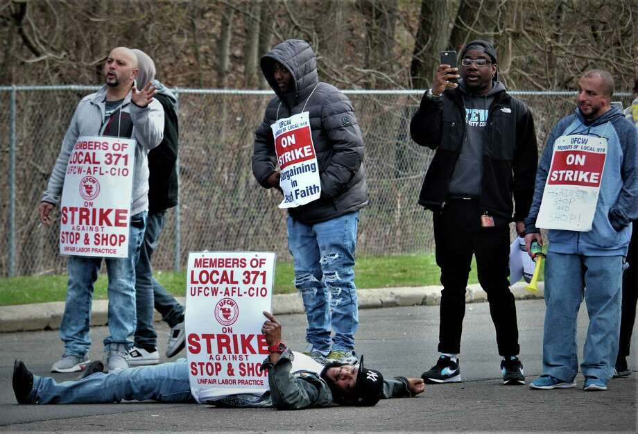 "Edward ""Skip"" Robinson lay down at the picket line of the Amity Stop & Shop store on Monday, April 15 to block a truck from entering. Robinson then negotiated with the driver -- who was picking up unsold matzoh, not delivering food. Photo: Dan Haar/Hearst Connecticut Media"