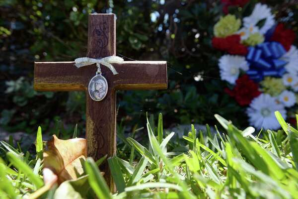 A cross and flowers were placed at the locations where Anthony Wilson was murdered Thursday night on Madrid Street in Beaumont. Photo taken Monday, 4/15/19