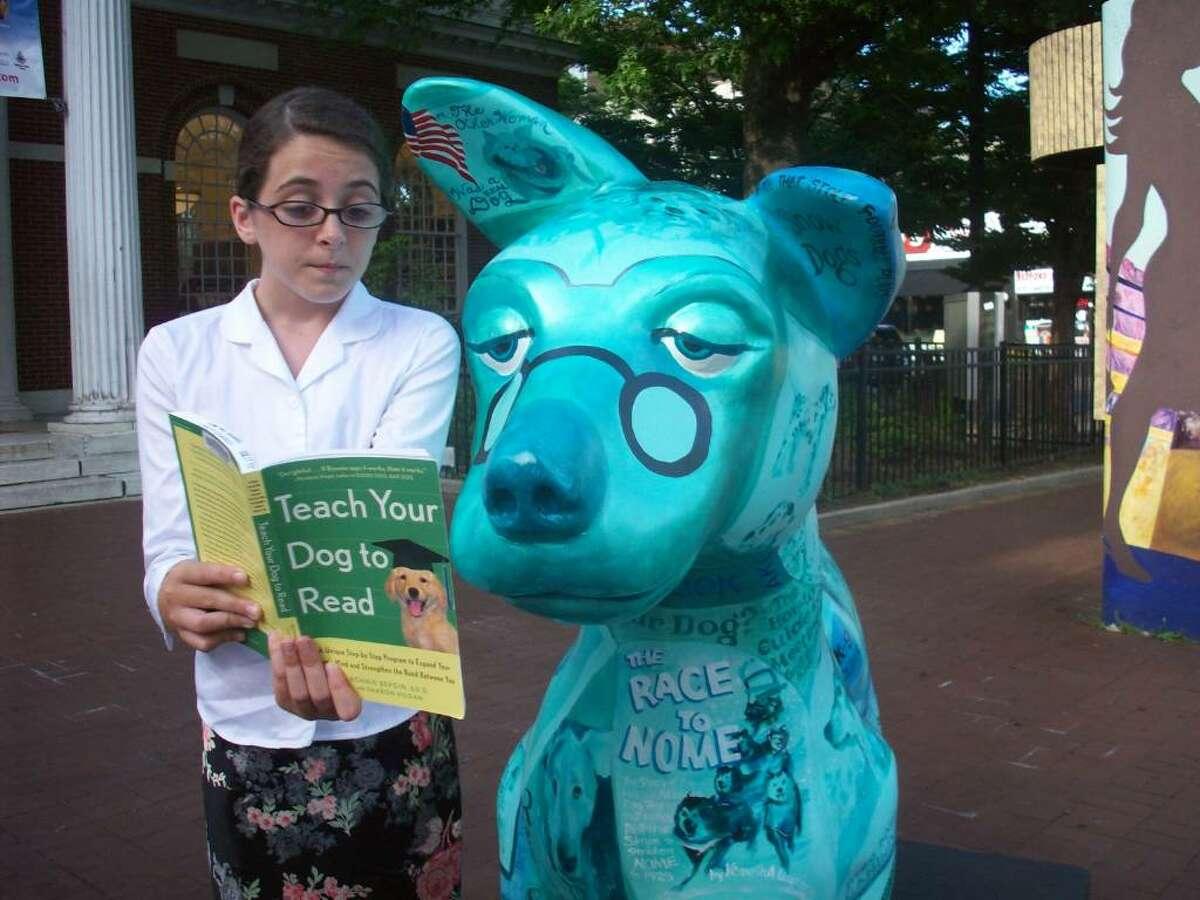 """Isabel Lane, 11, with Kathy Hirshon's """"Dog Tales."""""""