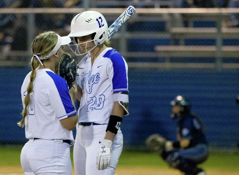 In this file photo, Oak Ridge's Brittany Cobb, right, talks with Kennedy Reynolds during the second inning of a District 15-6A high school softball at Oak Ridge High School, Friday, March 8, 2019, in Oak Ridge. Photo: Jason Fochtman, Houston Chronicle / Staff Photographer / © 2019 Houston Chronicle
