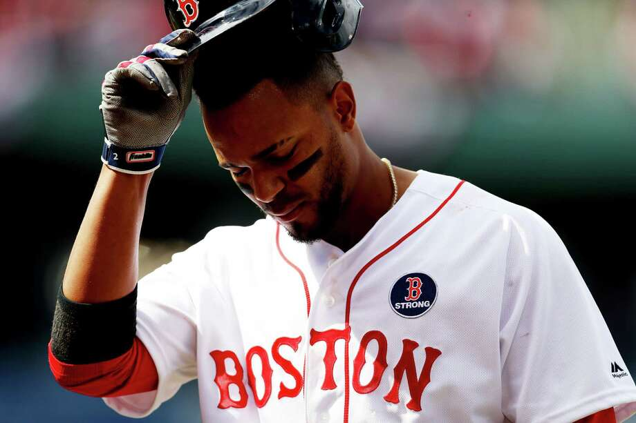 BOSTON, MASSACHUSETTS - APRIL 15: Xander Bogaerts #2 of the Boston Red Sox reacts during the ninth inning of the game against the Baltimore Orioles at Fenway Park on April 15, 2019 in Boston, Massachusetts. All uniformed players and coaches are wearing number 42 in honor of Jackie Robinson Day. The Orioles defeat the Red Sox 8-1. (Photo by Maddie Meyer/Getty Images) Photo: Maddie Meyer / 2019 Getty Images