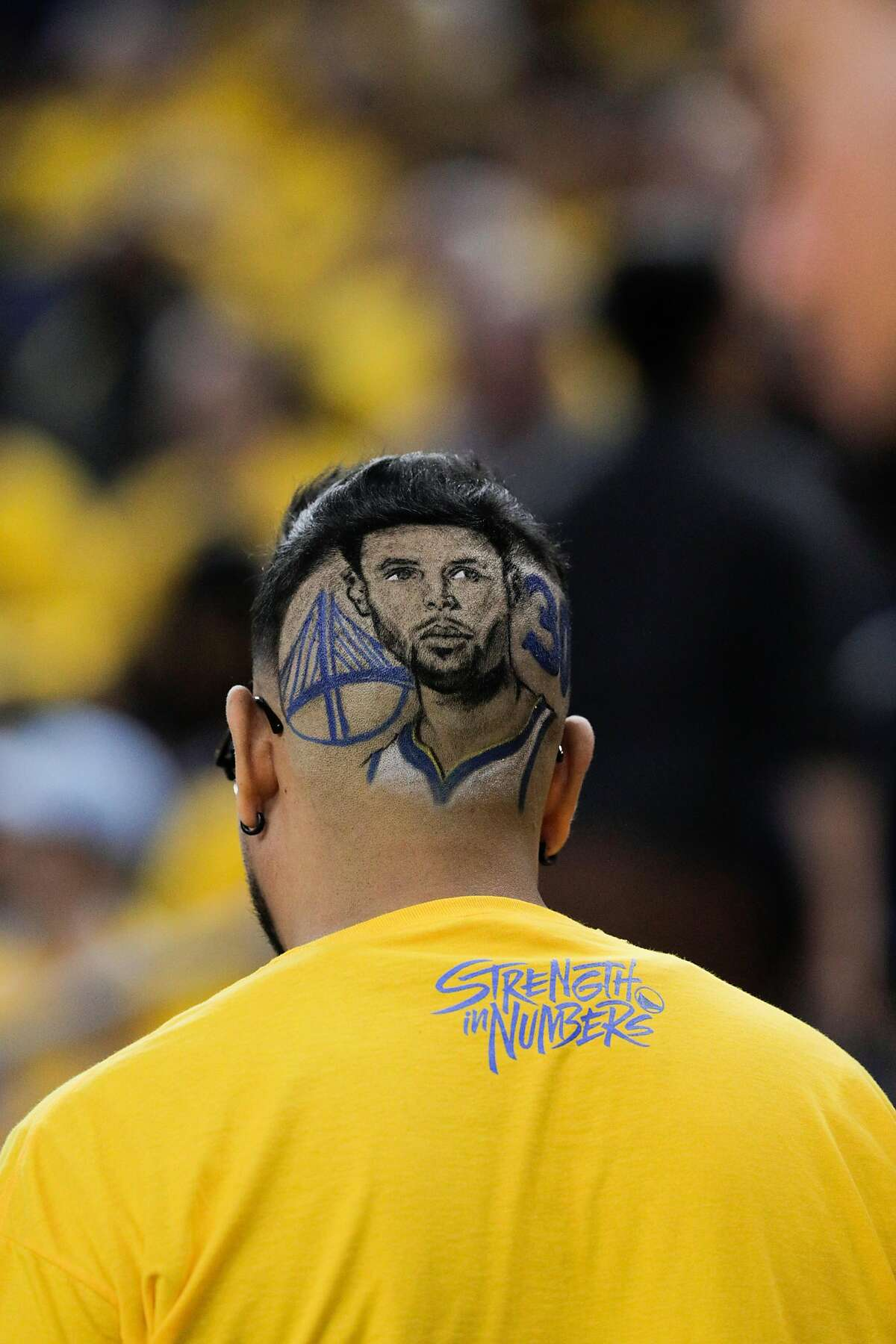 A Golden State Warriors fan displays a unique haircut during game 2 of the Western Conference Playoffs between the Golden State Warriors and the Los Angeles Clippers at Oracle Arena on Monday, April 15, 2019 in Oakland, Calif.