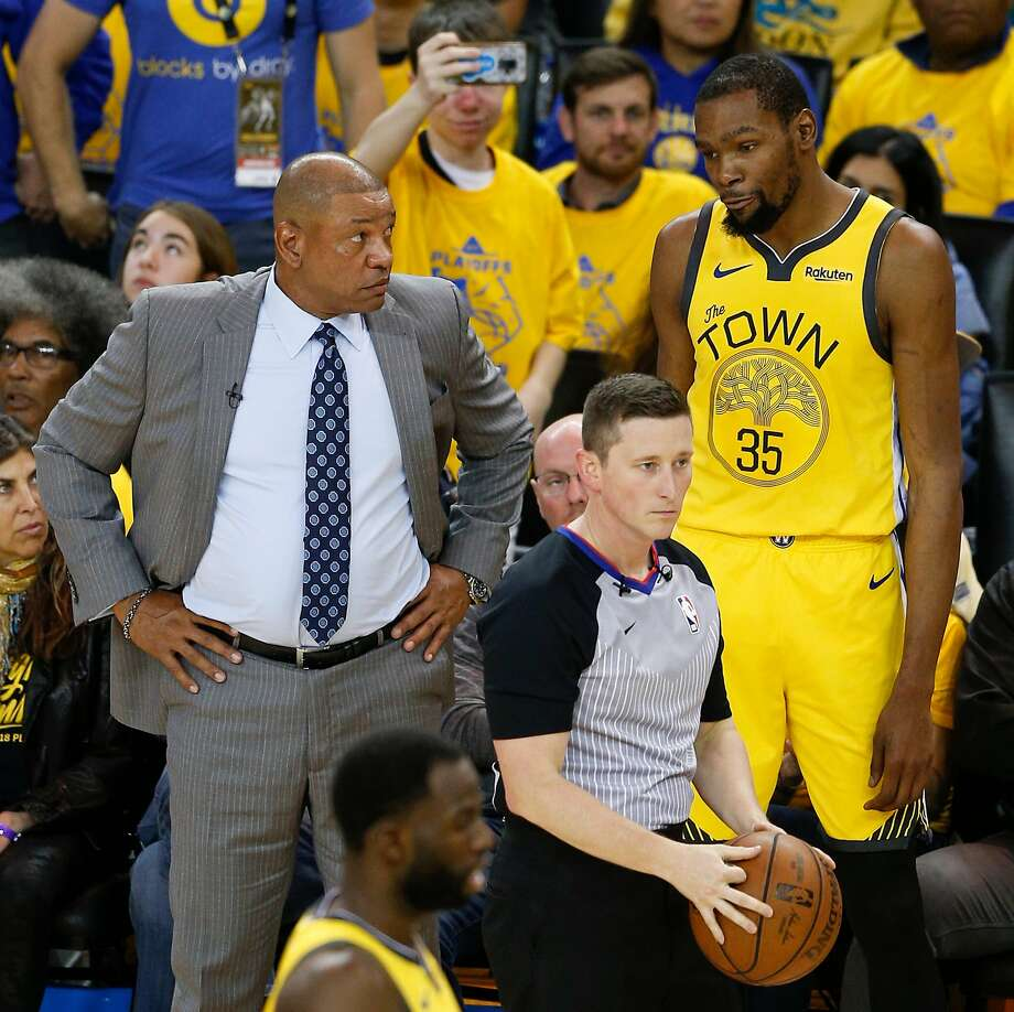 Los Angeles Clippers head coach Doc Rivers talks to Golden State Warriors Kevin Durant in the third quarter during game 2 of the Western Conference Playoffs between the Golden State Warriors and the Los Angeles Clippers at Oracle Arena on Monday, April 15, 2019 in Oakland, Calif. Photo: Santiago Mejia / The Chronicle