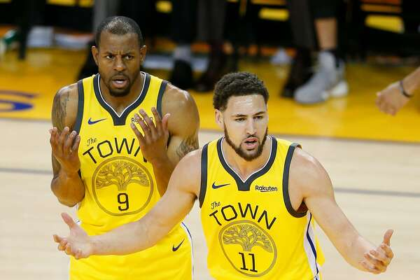 Golden State Warriors Andre Iguodala and Klay Thompson react to a foul call against Thompson in the second quarter during game 2 of the Western Conference Playoffs between the Golden State Warriors and the Los Angeles Clippers at Oracle Arena on Monday, April 15, 2019 in Oakland, Calif.