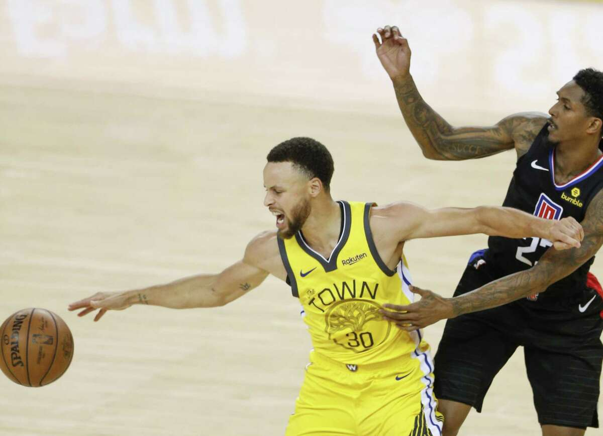 Golden State Warriors Stephen Curry loses the ball defended by Los Angeles Clippers Lou Williams in the fourth quarter during game 2 of the Western Conference Playoffs between the Golden State Warriors and the Los Angeles Clippers at Oracle Arena on Monday, April 15, 2019 in Oakland, Calif.