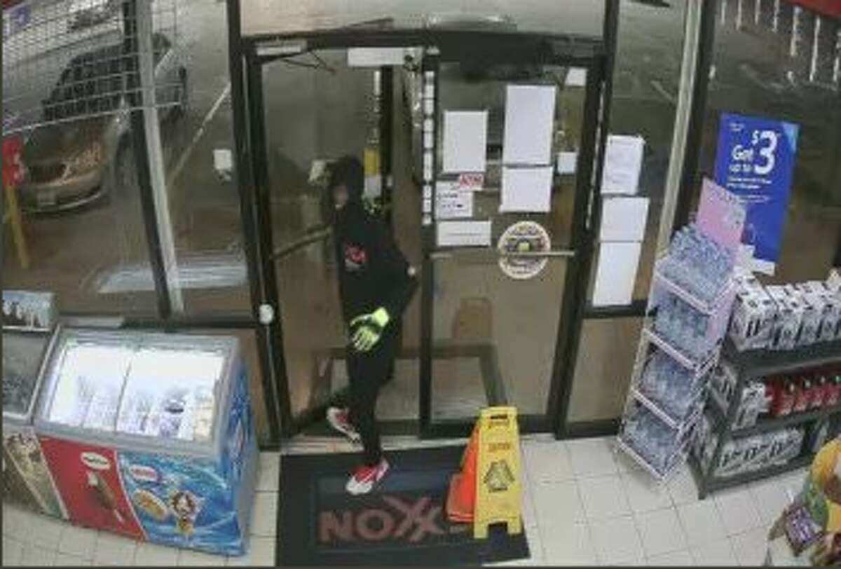 Houston police released surveillance images of the three suspects involved in a robbery shooting late Monday that left a clerk dead.