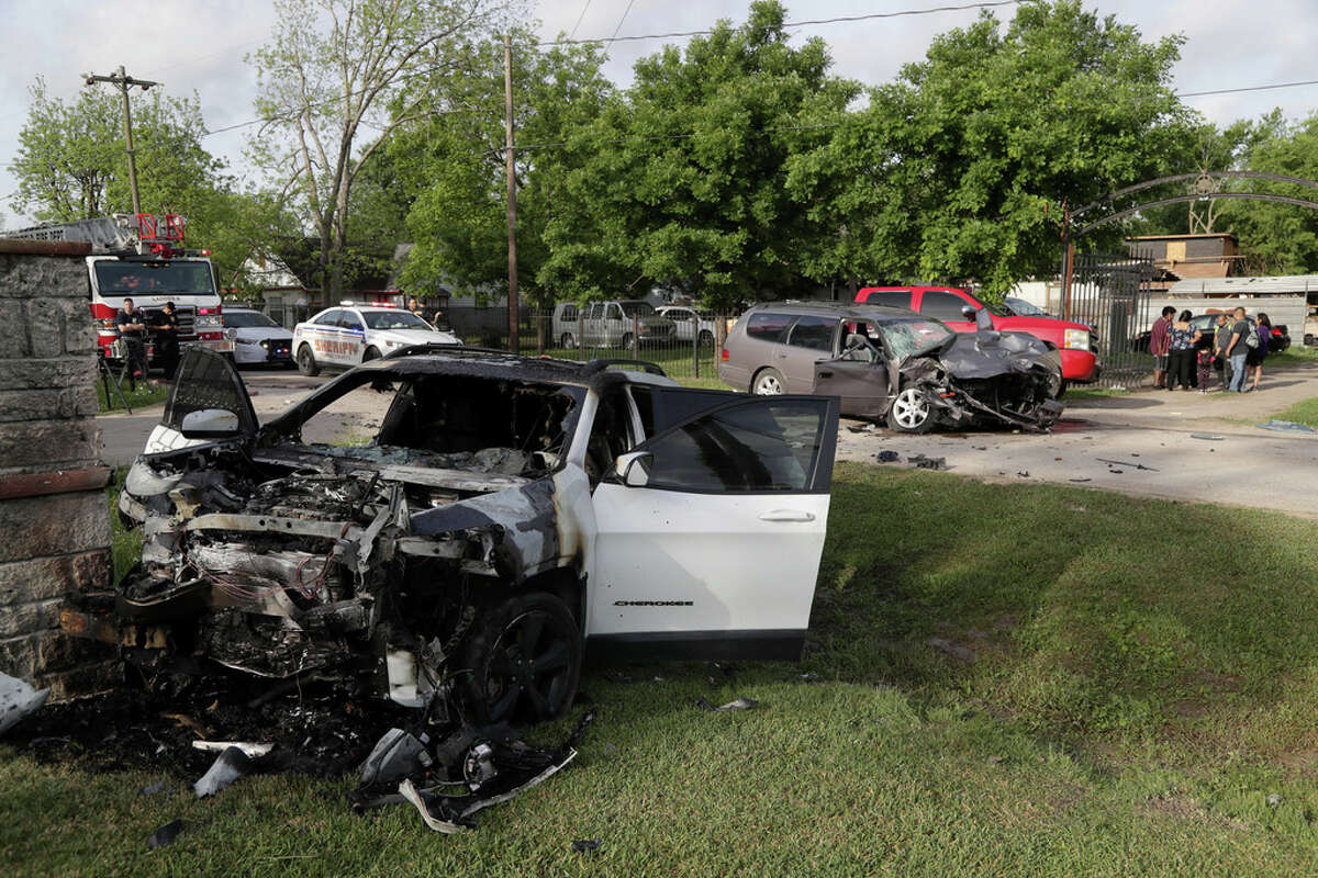 Authorities investigate the scene of a two-vehicle crash in the 11800 block of Vickery Tuesday, April 16, 2019, in Houston.