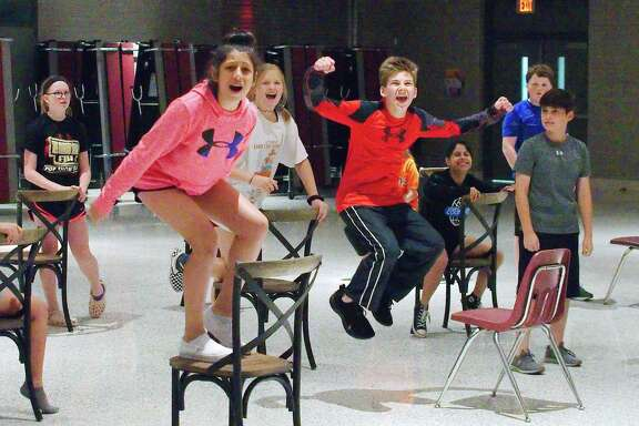 "Kennedy Cooper, left, Rianna Baghalian, Hannah Hefner, Zach Kornegay, Kamryn Ortiz, Trey Underwood and Michael McNeil demonstrate some of the demanding moves required in Fairmond Junior High School's production of ""Matilda."" ""The choreographer did not water down the dance routines for our students,"" teacher/director Sarah Kouba says."