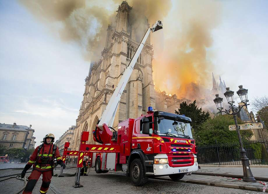 This photo provided on Tuesday April 16, 2019 by the Paris Fire Brigade shows fire fighters working at the burning Notre Dame cathedral, Monday April 15, 2019. Experts assessed the blackened shell of Paris' iconic Notre Dame Tuesday morning to establish next steps to save what remains after a devastating fire destroyed much of the cathedral that had survived almost 900 years of history. (Benoit Moser, BSPP via AP) Photo: Benoit Moser, Associated Press