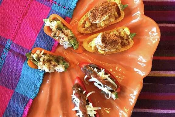 Clockwise from left, Guacamole- and Shrimp-Stuffed Mini Peppers, Mexican Street Corn-Stuffed Mini Peppers, Bean Dip- and Cheese-Stuffed Mini Peppers.