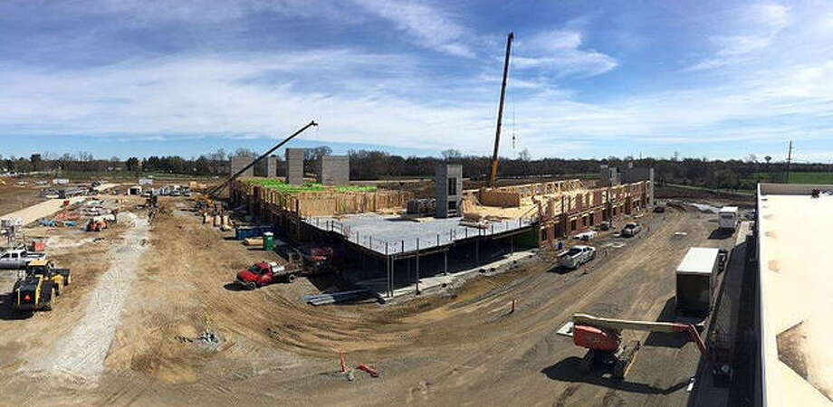 The latest drone shot from The Parkway during the week of April 8 shows wood framing rising quickly on one of Edwardsville's newest residential properties. Spring weather permits construction crews to make progress on The Parkway, situated on the former Madison Mutual Insurance site, on Route 157 between Governors' Parkway and Center Grove Road. The adjoining Kloss Furniture Store is slated to open on May 3. Photo: For The Intelligencer