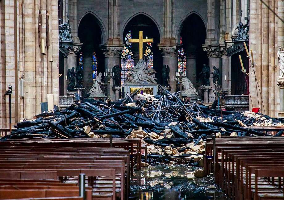 This general view shows debris inside the Notre-Dame-de Paris Cathedral in Paris on April 16, 2019, a day after a fire that devastated the building in the centre of the French capital. - Pledges from French billionaires, businesses and the public sector to help rebuild Notre-Dame cathedral have reached nearly 700 million euros (790 million dollars) amid an outpouring of public support for one of Europe's most iconic monuments. (Photo by Christophe PETIT TESSON / POOL / AFP)CHRISTOPHE PETIT TESSON/AFP/Getty Images Photo: Christophe Petit Tesson, AFP/Getty Images