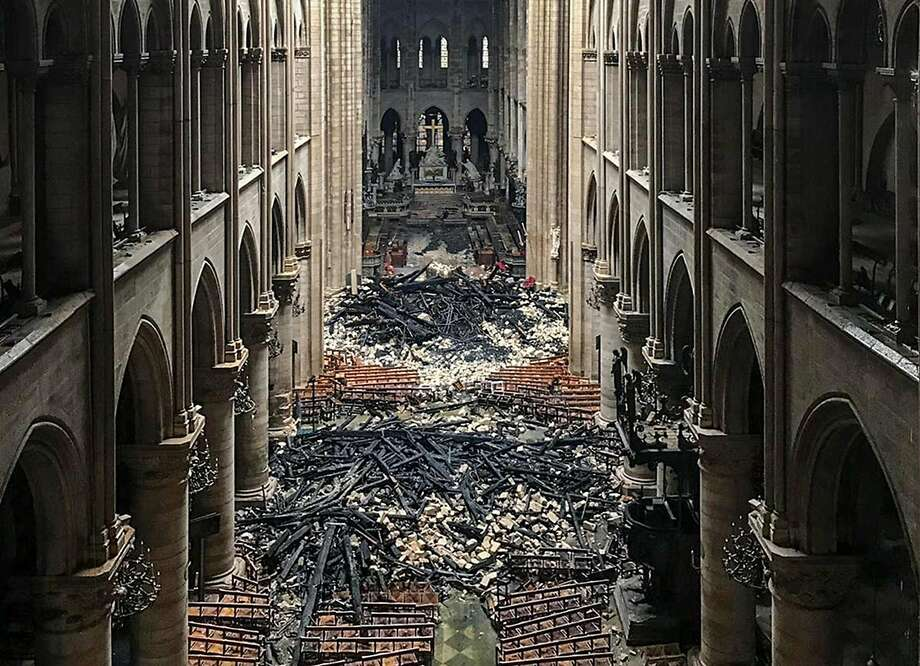 A picture taken on April 16, 2019 shows an interior view of the Notre-Dame Cathedral in Paris in the aftermath of a fire that devastated the cathedral. - The Paris fire service announced that the last remnants of the blaze were extinguished on April 16, 15 hours after the fire broke out. Thousands of Parisians and tourists watched in horror from nearby streets on April 15 as flames engulfed the building and rescuers tried to save as much as they could of the cathedral's treasures built up over centuries. (Photo by - / AFP)-/AFP/Getty Images Photo: -, AFP/Getty Images