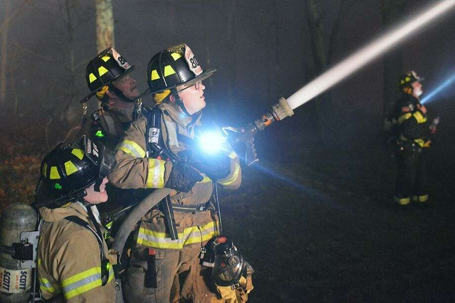 Members of Haddam Volunteer Fire Co. helped Killingworth firefighters knock down a blaze at a residence in the 800 block of Route 148. Photo: Olivia Drake Photo