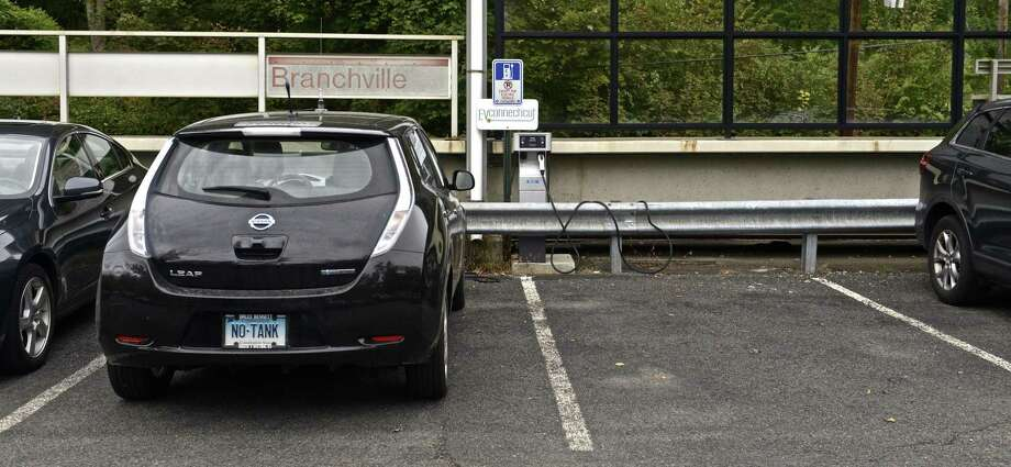 A Nissan Leaf is connected to the EVConnecticut electric vehicle charging station at the Branchville Metro North train station in Ridgefield, Conn, on Thursday, October 1, 2015. Photo: H John Voorhees III / Hearst Connecticut Media / The News-Times