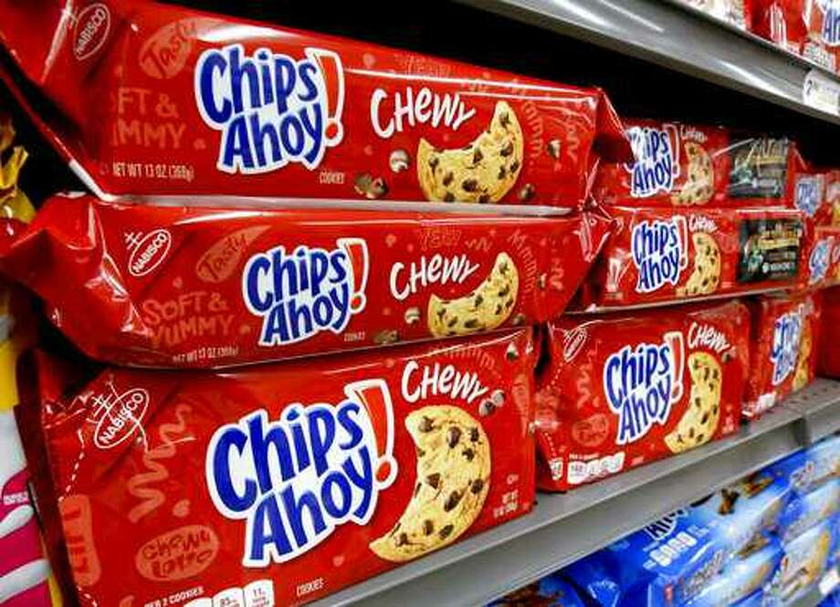 FILE-- Packages of Nabisco Chips Ahoy cookies line a shelf in a market in Pittsburgh on Aug. 8, 2018.
